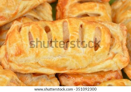 Bun with apple jam, close up, DOF - stock photo