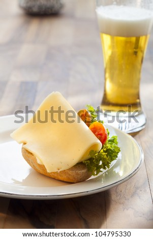 bun with cheese and a beer - stock photo