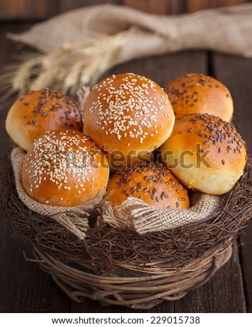 bun with flax seed and sesame seeds - stock photo