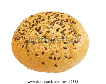 bun with sesame seeds and flax isolated on white background