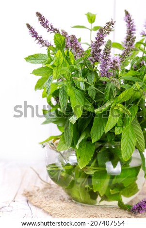 Bunch blooming mint on a wooden background. - stock photo