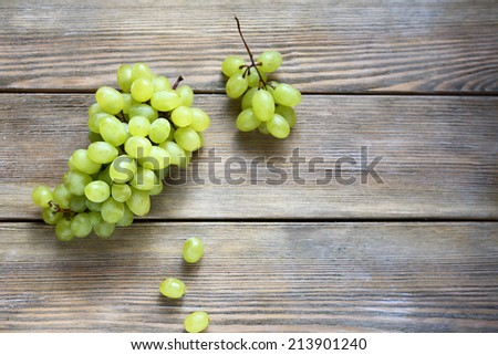 bunch green grapes on wooden background, , food closeup - stock photo