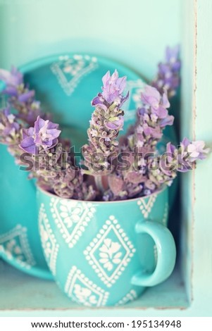 bunch of a lavender flowers in a blue tea mug .soft focus  - stock photo