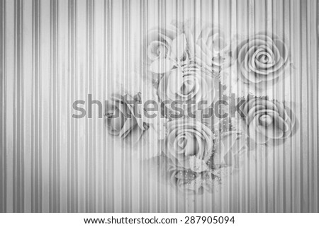bunch of artificial flower on metal sheet background in black and white tone - stock photo