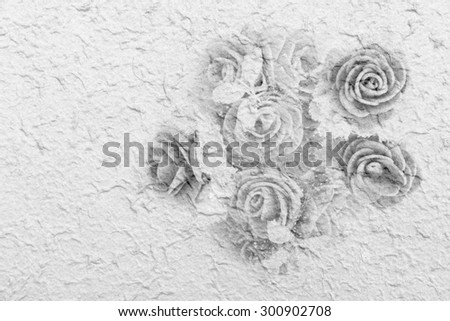 bunch of artificial flower on mulberry paper background ,black and white tone - stock photo