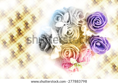 bunch of artificial flower on multicolor  background - stock photo