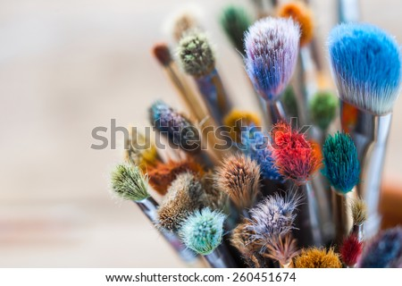Bunch of artist paintbrushes closeup, selective focus. - stock photo