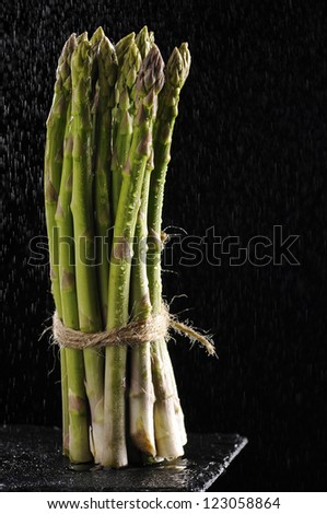 Bunch of asparagus on black background