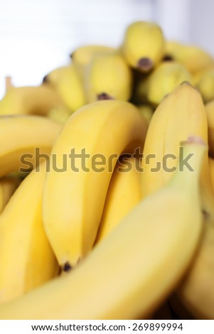 Bunch of bananas on boxes nature yellow - stock photo