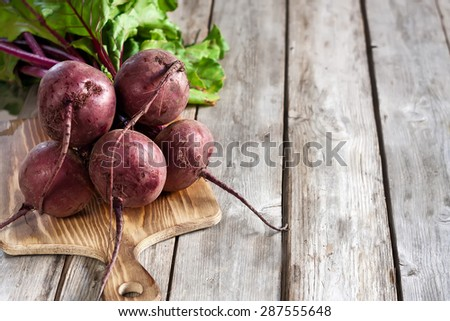 Bunch of beetroots. Copy space background. - stock photo