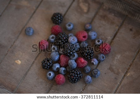 bunch of berries in a wooden basket - stock photo