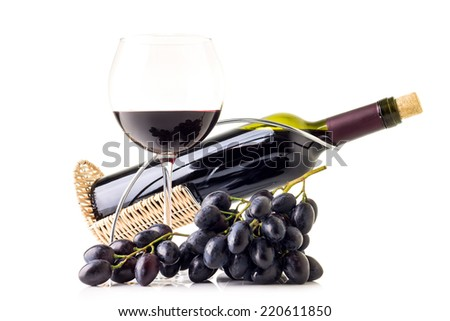 Bunch of blue grapes with bottle of red wine and glass isolated on white background - stock photo