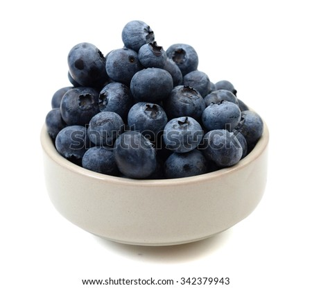 bunch of blueberries in bowl isolated on white