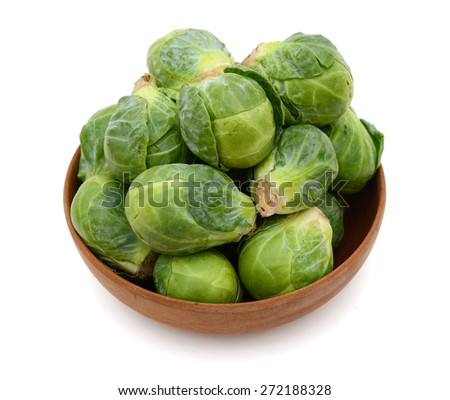 bunch of brussel sprouts in bowl on white background