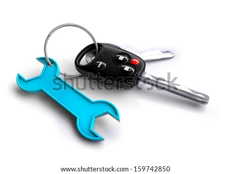 bunch of car keys with spanner keyring. Concept for car / vehicle servicing and maintenance. - stock photo