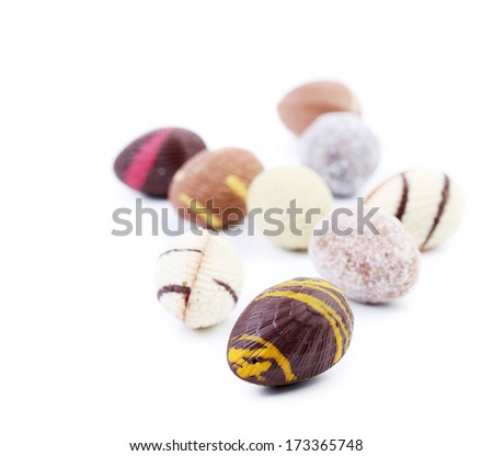 Bunch of chocolate seashells and stones. Isolated on a white background.
