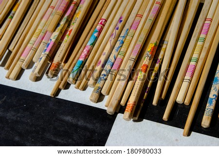 Bunch of chopsticks on black and white background