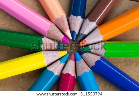 bunch of color pencils  on wood background - stock photo