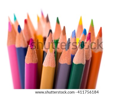 Bunch of color pencils over white background