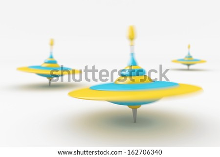 Bunch of colorful dreidels for Hanukkah spinning on white background. - stock photo