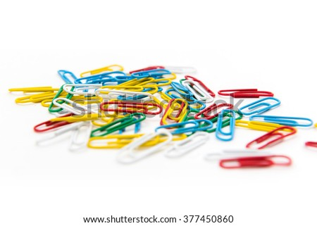 Bunch of colorful paper clips isolated on white background - stock photo