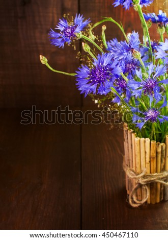 Bunch of cornflowers on a wooden surface