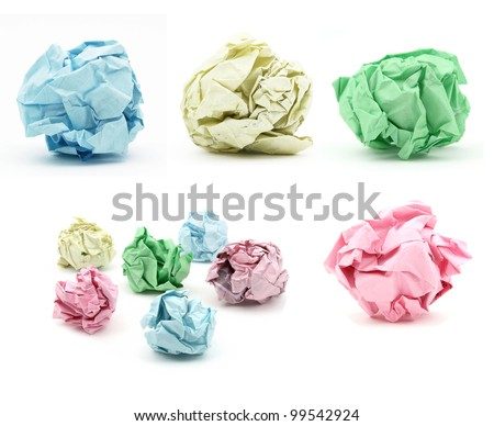 Bunch of crumbled color paper on white background