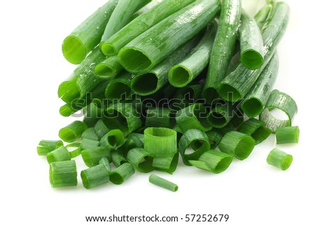 bunch of cut green onions on a white background