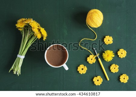 Bunch of dandelions, flowers and coffee