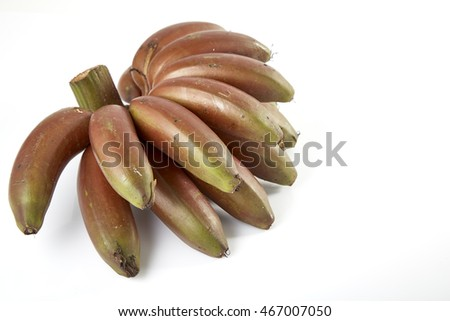 Bunch of dark red bananas isolated over white background