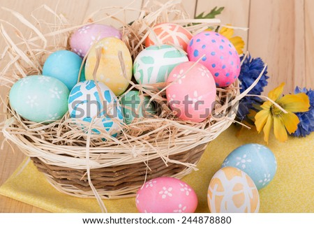 Bunch of decorative Easter eggs in a basket  - stock photo