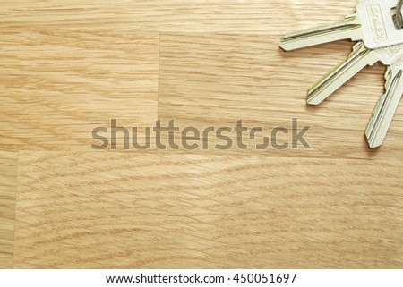 Bunch of different keys on wooden table. copyspace