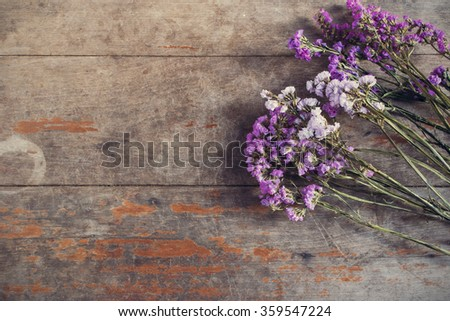 Bunch of dried flower on old wooden background. Rustic style. View from above