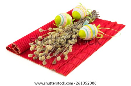 Bunch of easter pussy willow with easter eggs on red mat isolated on white background