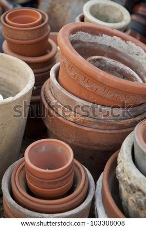 Bunch of empty flower pots put in each other waiting for spring garden work.