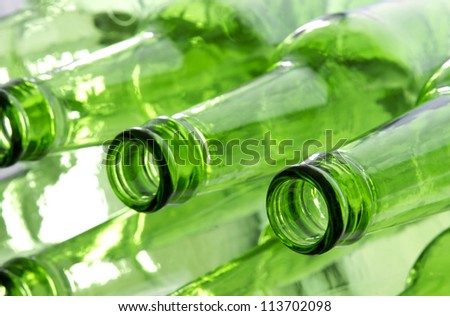 Bunch of empty glass beer bottles with back lighting. - stock photo