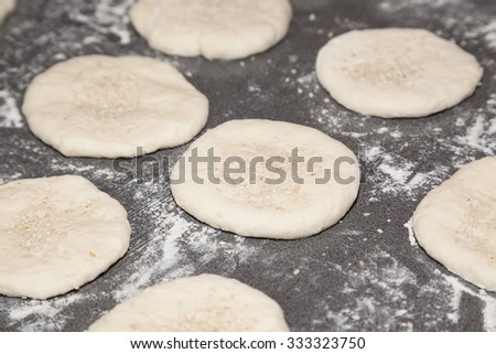 Bunch of flour dough bhaturas on table - stock photo