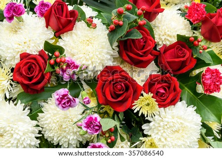 Bunch of flowers, flower bouquets including red roses, white chrysanthemums and violet carnations (dianthus caryophyllus).