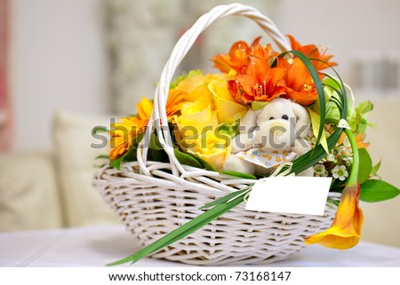 Bunch of flowers in a basket - stock photo