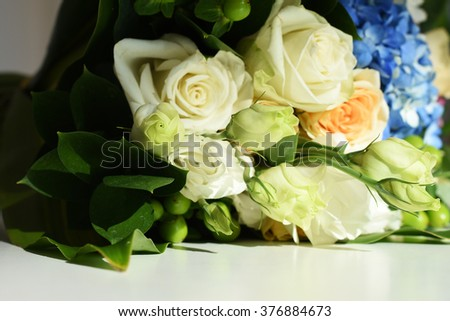 Bunch of flowers on a white table