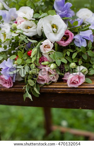 Bunch of flowers with pink, white and purple flowers on wood. Outdoor, green natural background