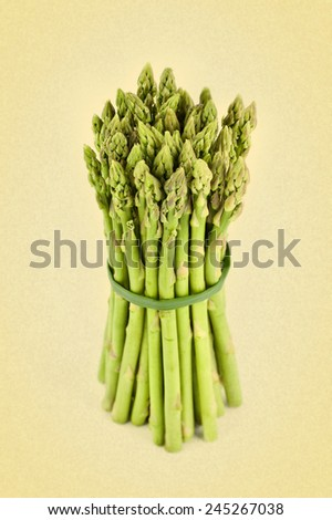 Bunch of fresh asparagus isolated on white background. picture in retro style. - stock photo