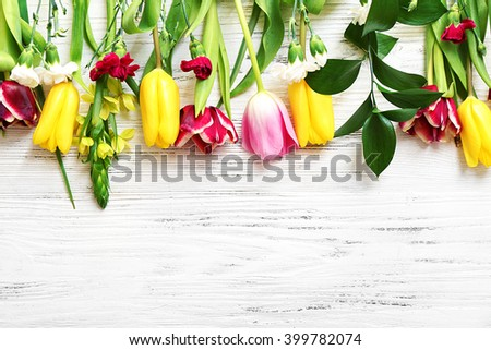 Bunch of fresh flowers on the white table. Top view. - stock photo