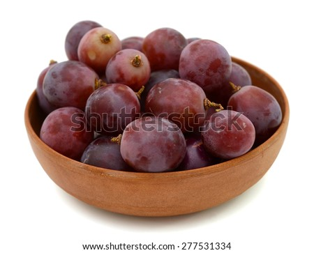 bunch of fresh grapes in bowl isolated  - stock photo