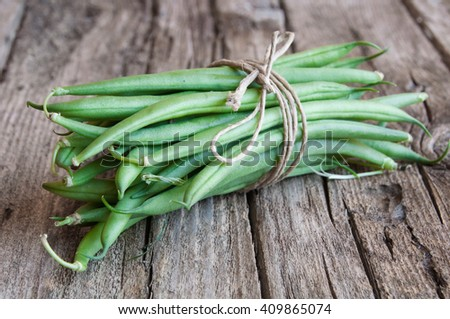 Bunch of fresh green beans on wood
