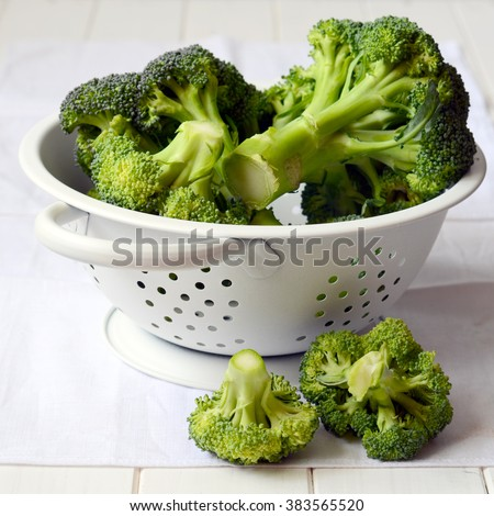 Bunch of fresh green broccoli, on the kitchen table