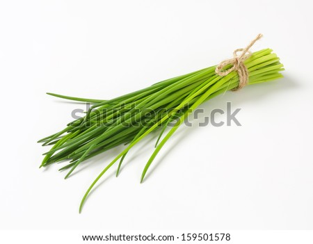 Bunch of fresh green chive on white background - stock photo