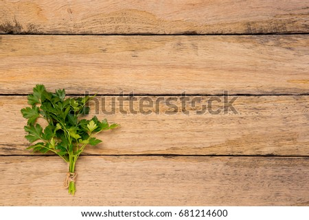 Bunch Of Fresh Italian Parsley Tied With String On Rustic Old Wooden Background