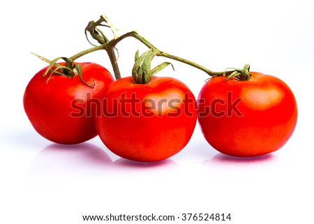 Bunch of fresh italian tomatoes . Isolated on white background. - stock photo