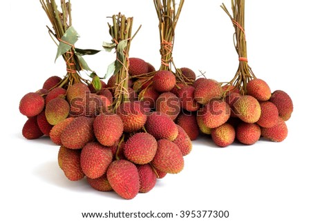 Bunch of fresh lychee on white background. - stock photo